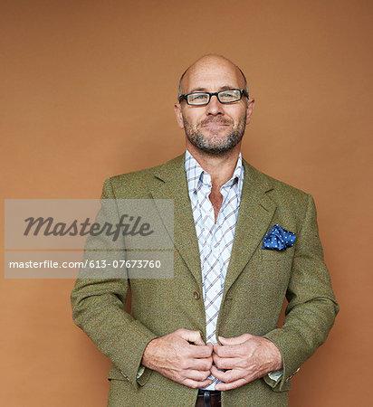 portrait of mature man in tweed jacket