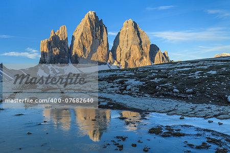 Tre cime di Lavaredo reflected from a lake, Dolomite Alps, Italy