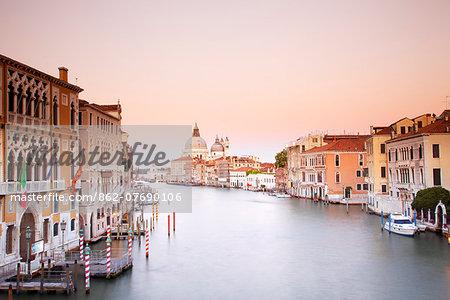 Italy, Veneto, Venice. The Grand Canal and church of Santa Maria della Salute in the background. UNESCO.