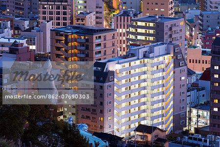 Asia, Japan, Kyushu, Nagasaki, buddhist statue surrounded by city buildings