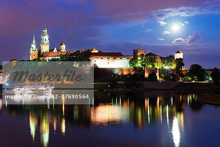 Europe, Poland, Malopolska, Krakow, full moon over Wawel Hill Castle and Cathedral, Vistula River, Unesco site