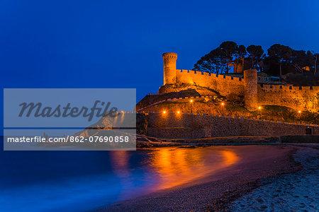 Night view of Vila Vella, the medieval old town of Tossa del Mar, Costa Brava, Catalonia, Spain