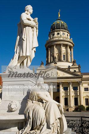 Statue of Fredrich Schiller and French Cathedral in Gerndarmenmarkt, Berlin, Germany