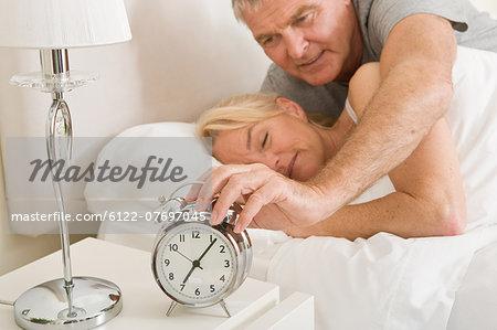 Man reaching to turn off alarm