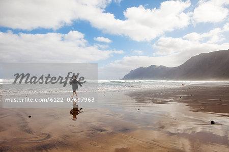 Boy running on a beach
