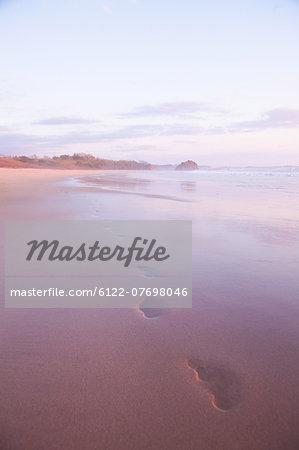 Footprints in sand at sunset, Playa Grande, Santa Cruz, Costa Rica