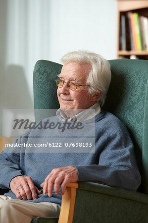 Senior man in armchair, portrait