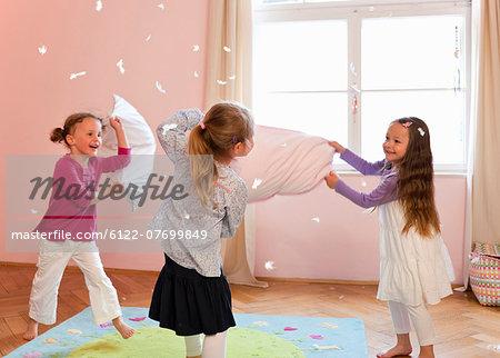 Girls having a pillow fight