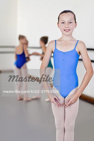 Ballet dancer standing in studio