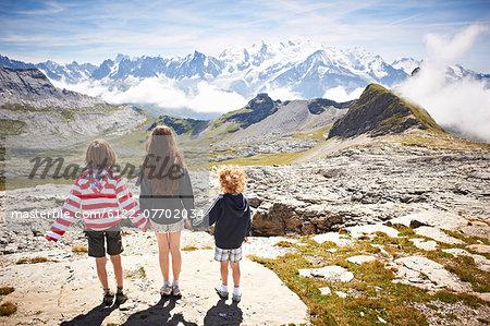Children standing in rocky landscape
