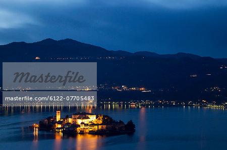 Village on island lit up at night