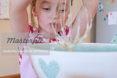 Girl whisking in kitchen