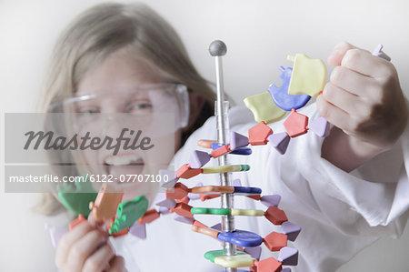 Girl breaking molecular model