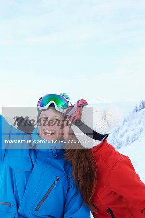 Skiers kissing in snow