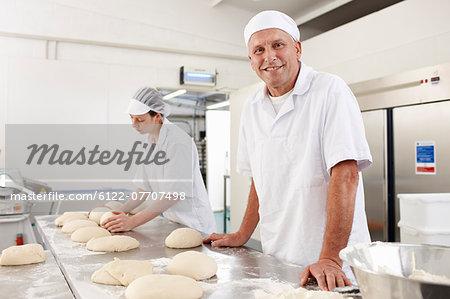 Chefs baking in kitchen
