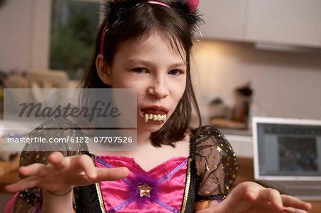 Girl wearing Halloween costume