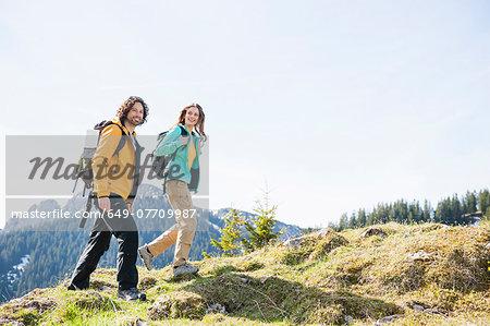 Mid adult couple nordic walking through Tegernsee, Bavaria, Germany