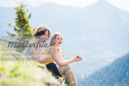 Mid adult couple having picnic, Tegernsee, Bavaria, Germany