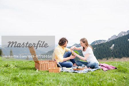 Mid adult couple having picnic, Wallberg, Tegernsee, Bavaria, Germany