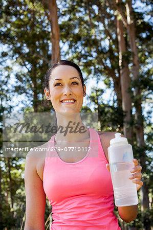 Female jogger holding water bottle