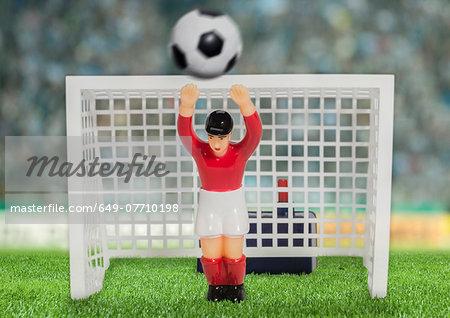 Digitally generated image of soccer goalkeeper in stadium