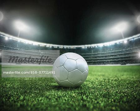 Soccer ball in a stadium at night