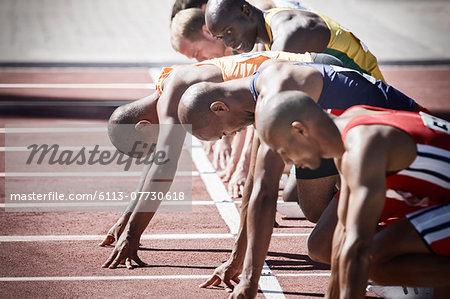 Runners preparing at starting line