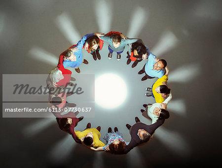 Diverse group around bright light