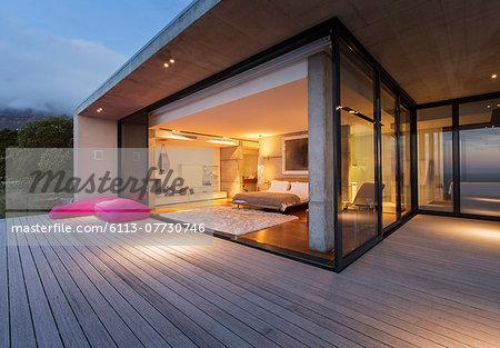 Sliding glass doors onto bedroom of modern house