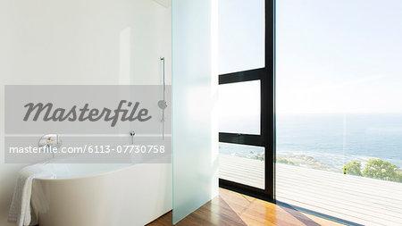 Bathtub and sliding glass door of modern house