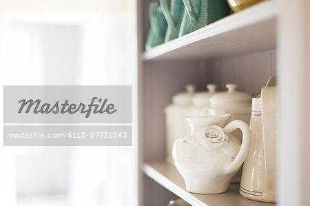 Close up of ceramics on kitchen shelf