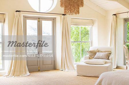 Front door and armchair in rustic house
