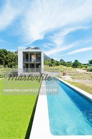 Modern swimming pool under blue sky