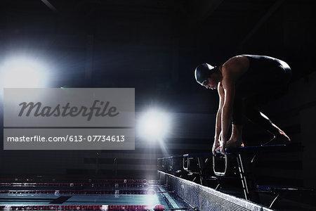 Swimmer preparing on starting platform