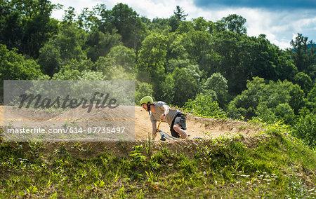 Mountain biker speeding around bend on rural pump track