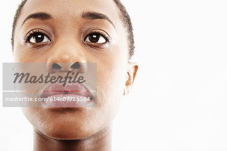 Close up studio portrait of sad young woman