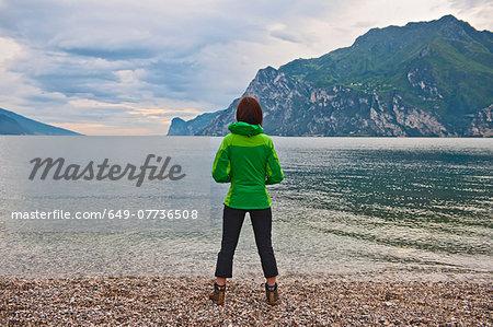 Woman looking out Lake Garda, Riva Del Garda, Trentino, Italy