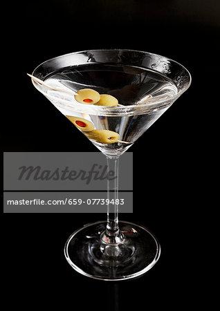A martini against a black background
