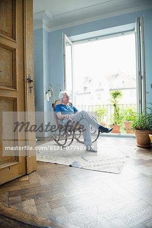 Mature man sitting in rocking chair