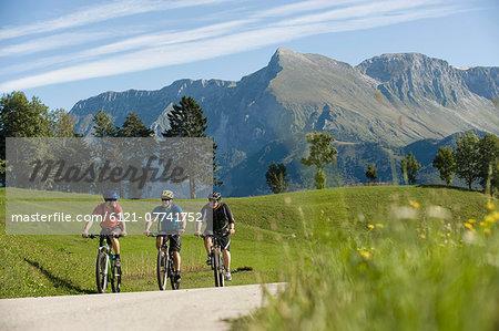 three mountain bikers on the way, Matajur, Istria, Slovenia