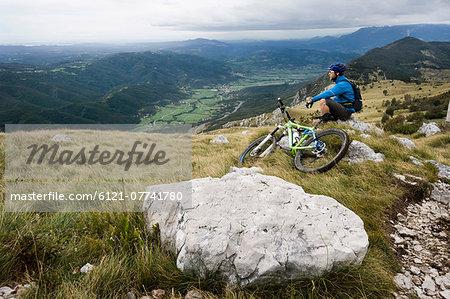 mountain biker having a rest, Vipava valley, Istria, Nanos, Slovenia