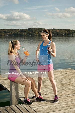Jogging women taking a break, Woerthsee, Bavaria, Germany