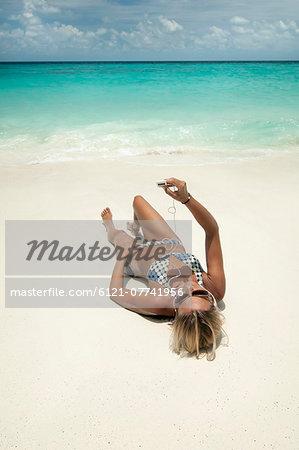 woman listening music on the beach, Koh Lipe, Thailand