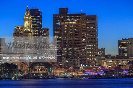 Boston skyline at dusk viewed from East Boston, Massachusetts, USA