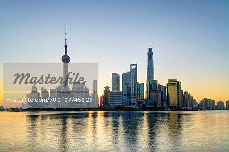 Lujiazui financial district with the Oriental Pearl Tower, Jinmao Tower, Shanghai World Financial Centre and Shanghai Tower at sunrise, Pudong, Shanghai, Shanghai Shi, Zhonghua, China