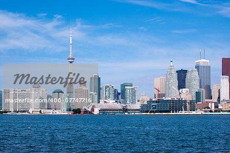 Toronto skyline under a clear sky.