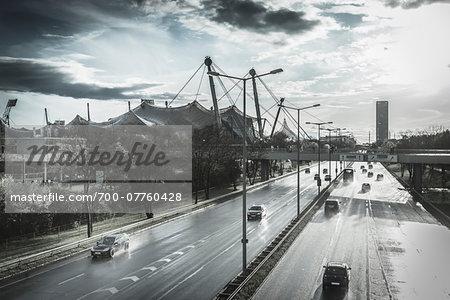 Cars on Road on Rainy Day near Olympiapark, Munich, Bavaria, Germany