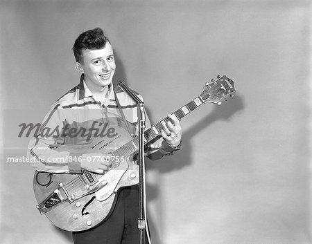 1950s TEENAGE BOY SINGING PLAYING GUITAR INTO MICROPHONE