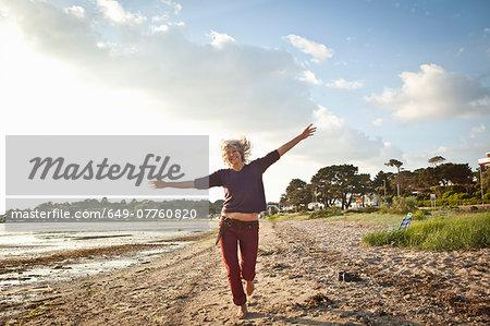 Mature woman enjoying beach