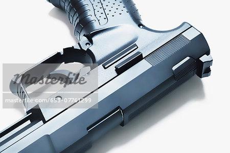 Close-up of a handgun, viewed upside down